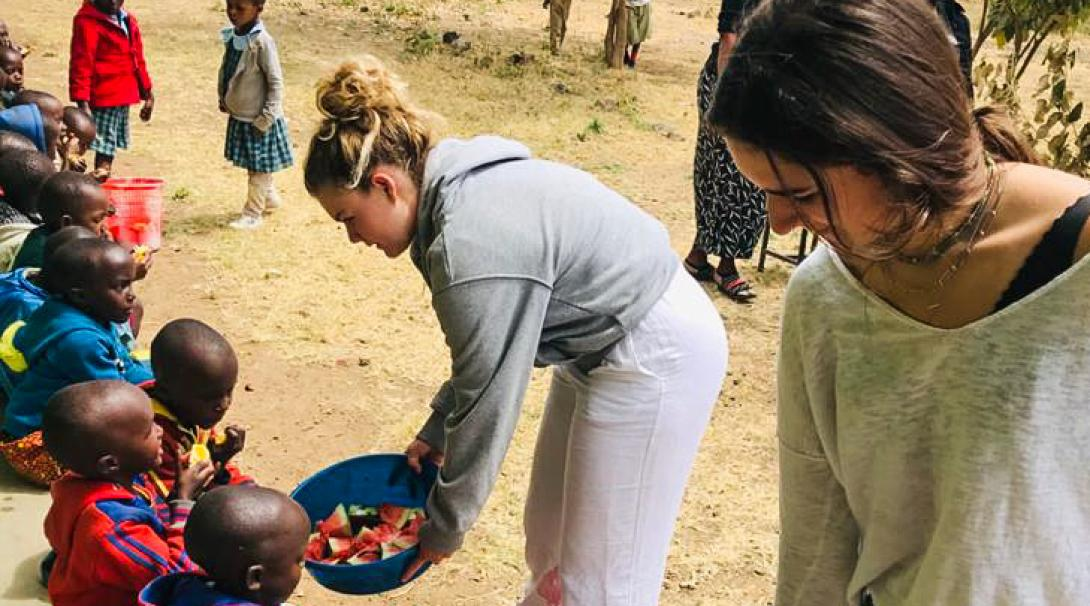 Projects Abroad volunteers provide snacks to Children in Arusha, Tanzania
